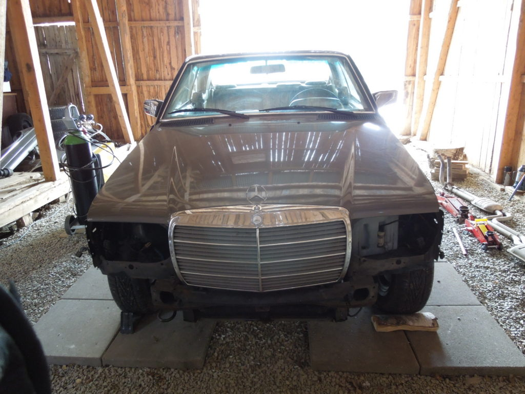Stripped car 280CE front