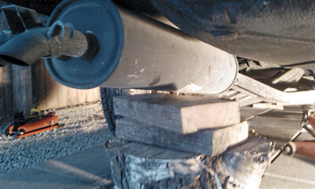 rear muffler supported with wood