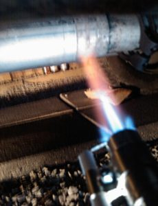 gas torch on exhaust