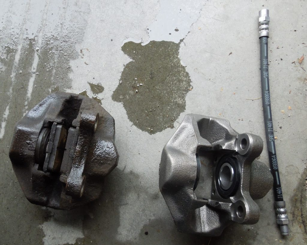 old and new rear caliper compared