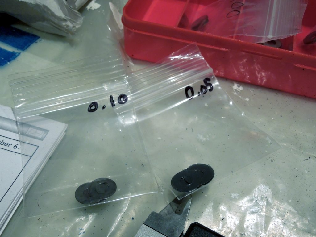 Adjustment shims for injectors