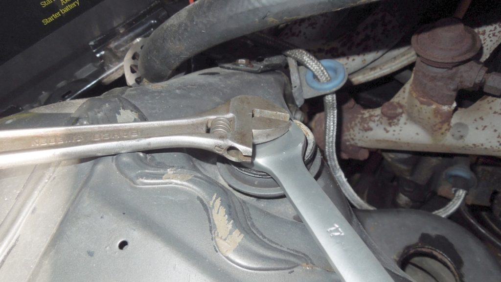 removing top nuts shock absorbers w123