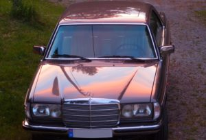 Mercedes 280CE in sunset
